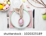 beautiful festive easter table... | Shutterstock . vector #1020325189