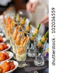 glasses with seafood snacks   ... | Shutterstock . vector #102036559