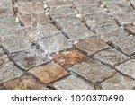 Water Drop  Splash On A Brick...