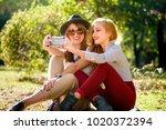 urban girlfriends taking a... | Shutterstock . vector #1020372394
