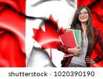 happy female student holdimg... | Shutterstock . vector #1020390190