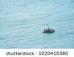 seascape with a fisherman's... | Shutterstock . vector #1020410380