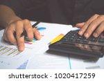 a man hand holding pen and... | Shutterstock . vector #1020417259