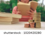 a stack of books and glasses on ... | Shutterstock . vector #1020420280