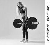 black n white photo of female... | Shutterstock . vector #1020428050