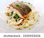 tasty pasta with salmon on a... | Shutterstock . vector #1020433426