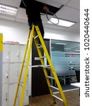 Small photo of Electricians are dragging the cord repair lighting in offices.