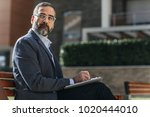 handsome caucasian businessman... | Shutterstock . vector #1020444010