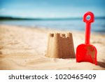 sandcastle with a shovel on the ... | Shutterstock . vector #1020465409