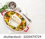 fish cod baked in the oven with ... | Shutterstock . vector #1020475729