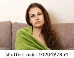 preaty sad girl sitting alone.... | Shutterstock . vector #1020497854