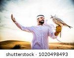 arabian man walking  in the... | Shutterstock . vector #1020498493