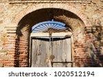 old wood door between brick...   Shutterstock . vector #1020512194