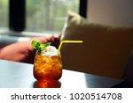 a glass of iced black tea mixed ...   Shutterstock . vector #1020514708