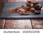 chocolate on old wooden table | Shutterstock . vector #1020522358