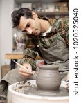 view at an artist makes clay... | Shutterstock . vector #1020525040