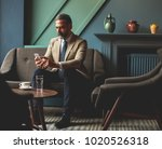 handsome senior businessman... | Shutterstock . vector #1020526318
