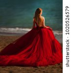 a woman in a red dress on the... | Shutterstock . vector #1020526579