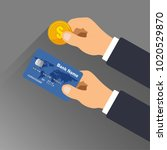 hand holding a credit card and...   Shutterstock .eps vector #1020529870