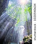 sun rays in a cave with falls.... | Shutterstock . vector #1020540634