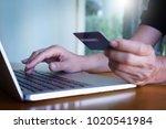 man's hands holding credit card ... | Shutterstock . vector #1020541984