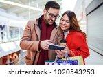 shopping time. beautiful young... | Shutterstock . vector #1020543253