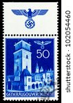 GERMANY - CIRCA 1940: A stamp printed in Germany showing buildings of Poland (City Hall Tower, Krakow) , circa 1940 - stock photo