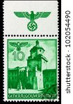 GERMANY - CIRCA 1940: A stamp printed in Germany showing buildings of Poland (Krakow Gate, Lublin) , circa 1940 - stock photo