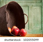Apples Spilling Out Of A Basket ...
