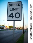 speed limit sign in a straight... | Shutterstock . vector #1020558424