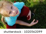 cute 7 years old girl sitting... | Shutterstock . vector #1020562099