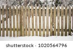 A Picket Fence Covered With...