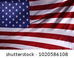 closeup of rippled american flag | Shutterstock . vector #1020586108