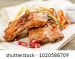 grilled pork ribs. serving on a ... | Shutterstock . vector #1020588709