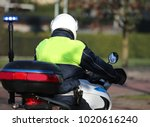 Policeman On A Motorcycle...
