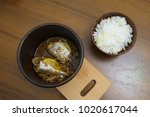 stewed hake fish with onion and ... | Shutterstock . vector #1020617044