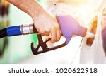 car at gas station being filled | Shutterstock . vector #1020622918