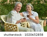 l senior couple drinking tea  | Shutterstock . vector #1020652858