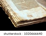 Small photo of Old book cover, vintage texture, isolated on black background. Old Jewish Talmud in Yiddish.