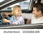 happy young father and his cute ... | Shutterstock . vector #1020686188