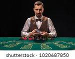 portrait of a croupier is... | Shutterstock . vector #1020687850