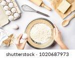 making dough top view. overhead ... | Shutterstock . vector #1020687973