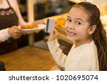 close up of a cheerful cute... | Shutterstock . vector #1020695074