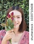 Stock photo asian women holding red rose in pink dress 1020710608
