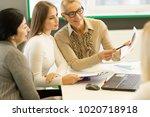 joyful beautiful mature... | Shutterstock . vector #1020718918