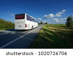 white bus traveling on asphalt... | Shutterstock . vector #1020726706