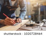 carpenter working on... | Shutterstock . vector #1020728464