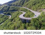 aerial view on road serpentine... | Shutterstock . vector #1020729334