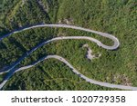 aerial view on road serpentine... | Shutterstock . vector #1020729358