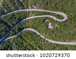 aerial view on road serpentine... | Shutterstock . vector #1020729370